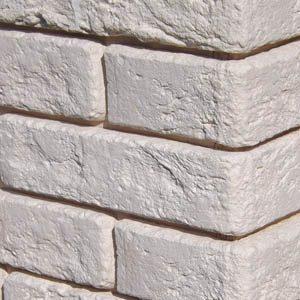 Облицовка гипсовой плиткой с имитацией кладки кирпича